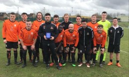 First team celebrate with Manager of the Month Jimmy Martin
